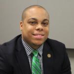 smiling young Black man wearing suit